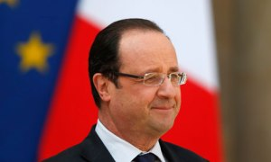 French President Francois Hollande waits for a guest on the steps of the Elysee Palace in Paris. Source: guardian.co.uk