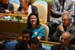 Luxembourg's Ambassador to the UN Sylvie Lucas (C) reacts to Security Council vote, 19 October 2012 (AFP)