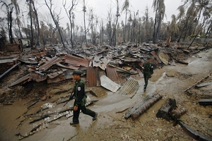 Source: www.hrw.org Soldiers patrol through a neighborhood that was burnt during recent violence against Muslims, 2012. © 2012 Reuters