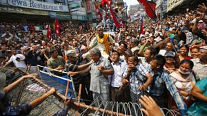 Nepali's hold a demonstration near the Constitution Assembly building in Kathmandu. They demanded that states proposed in the new constitution should not be determined on the basis of ethnicity. Source: Niranjan Shrestha/Associated Press