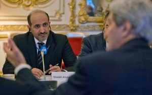Syrian opposition leader Ahmad al-Jarba listens as U.S. Secretary of State John Kerry speaks at the Geneva II peace talks (america.aljazeera.com)