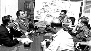 All Together Now: Iranian officials Hasan Toofanian and Bahram Ariana (left), meet with Israeli officers in 1975 (timesofisrael.com)