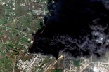 Smoke permeates the air in Homs, Syria as satellite images show the destruction of the country from above (world.time.com)