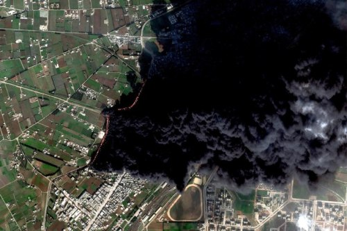 Death From Above: Smoke permeates the air in Homs, Syria as satellite images show the destruction of the country from above (world.time.com)